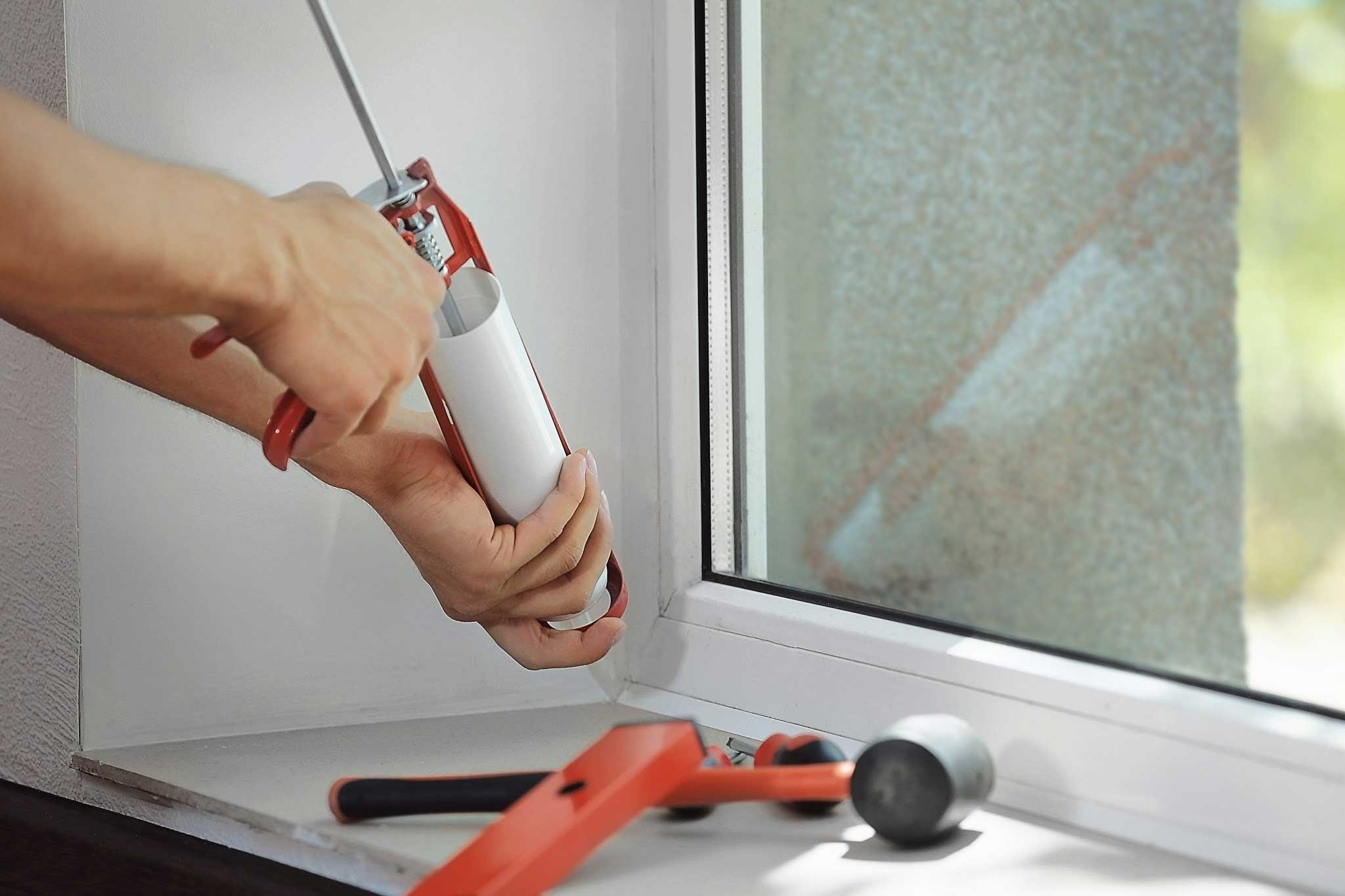 seal air leaks with new window caulk around window frame