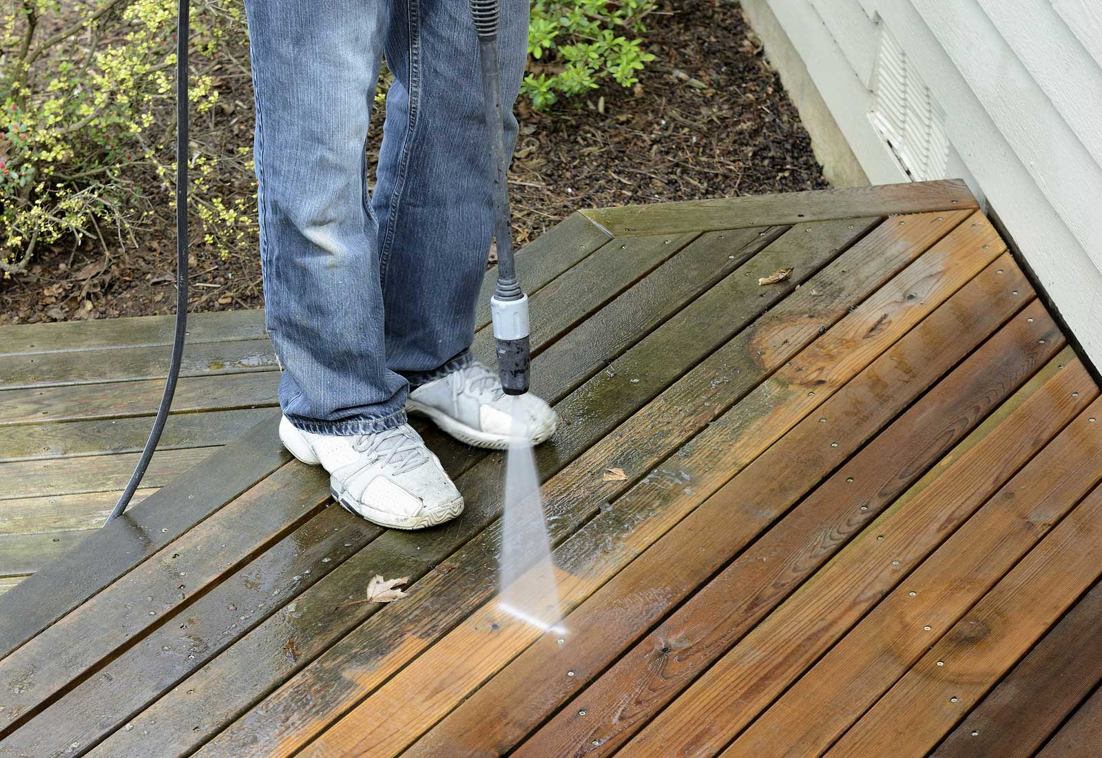 improve home curb appeal by powerwashing outdoor deck and patio
